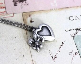 fleur de lis. heart locket necklace. in silver ox jewelry