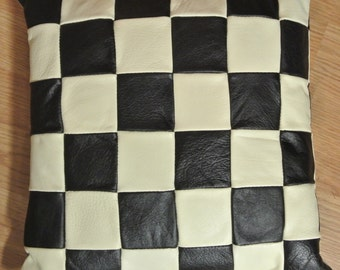 Unusual one-of-a-kind new/unused pillow of creame white and black skin/  leather in checkered pattern, alike at both sides