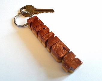 Custom Exotic Two-Tone Name Keychain in Sapele Pommele and Pau Amarello Woods, Carved to Order