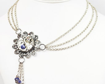 Steampunk Antiqued Silver Asymmetrical Necklace with Vintage Pocket Watch and Tanzanite Purple Swarovski Crystal Beads by Velvet Mechanism