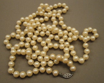 Vintage 52 inch long faux ivory pearls, Sterling Silver clasp, Wear as single, double or triple strand, Lovely vintage condition