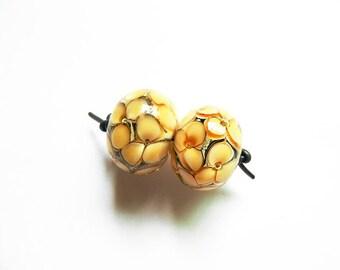 GOLDEN GARDEN   2 ivory, silver, deep and light topaz encased florals earring pair    A Beaded Gift