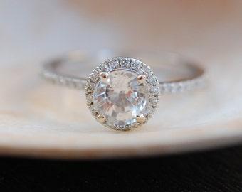 White sapphire ring. Whitegold engagement ring. Diamond halo ring. 1.12ct round white sapphire ring by Eidelprecious.