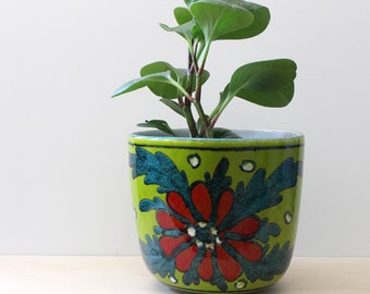 Vintage pottery planter, Red flower on green.