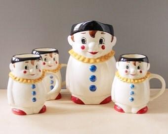 Goebel Clown pitcher and three mug lemonade set. Made in Germany.