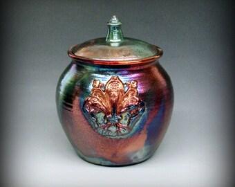 Raku Pottery, Raku Urn with Fleur De Lis in Metallic and Iridescent Colors