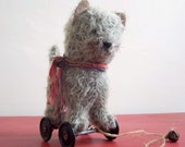 Little grey mohair kitten on vintage Meccano wheels