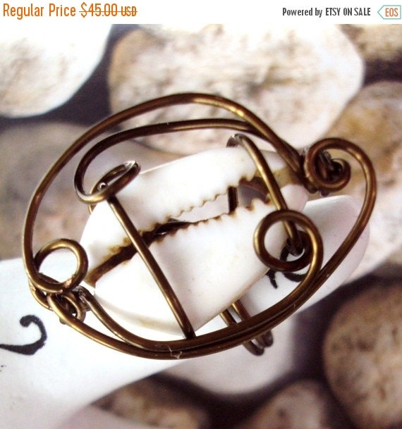 Announcement Wire Wrapped Cowrie Shell Ring Size 6 in Antiqued Copper Wire