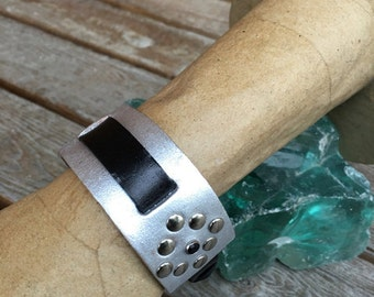 Silver leather watchband with rivets