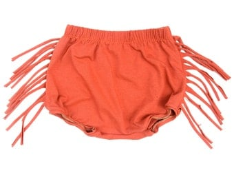 Girls Orange Fringe thigh length shorts