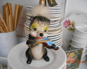 Vintage Porcelain Skunk playing Violin Figurine