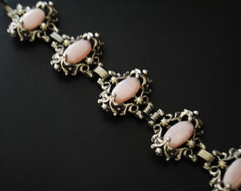 Victorian style vintage 50s silvertone metal bracelet with large ornate links and pink oval cabochon  as  a centerpiece. Size 7 1/2