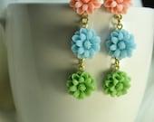 Flower earrings ... trio of daisy charms ... pretty pastels