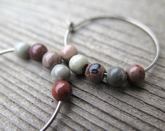red picture jasper earrings. grey stone earrings. hypoallergenic hoops in dark silver niobium.