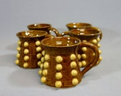 Dalek Abstract Mug: Brown and Gold Hobnail Mug