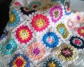 Crocheted Baby Blanket in Sunburst Design in Beautiful Bright Colours .Would suit a Boy or a girl.