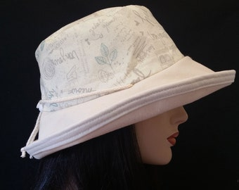 Sunblocker - Large brim sun hat with adjustable fit featuring very neutral print with fun words