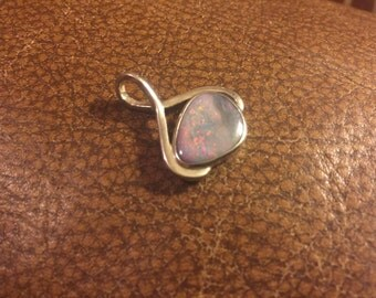 Sparkly fire filled opal pendant