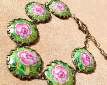 tin bracelet, recycled tin, pink roses, pink and green, tin container, metal, reused tin container,flower bracelet, girly, pink flowers, tin