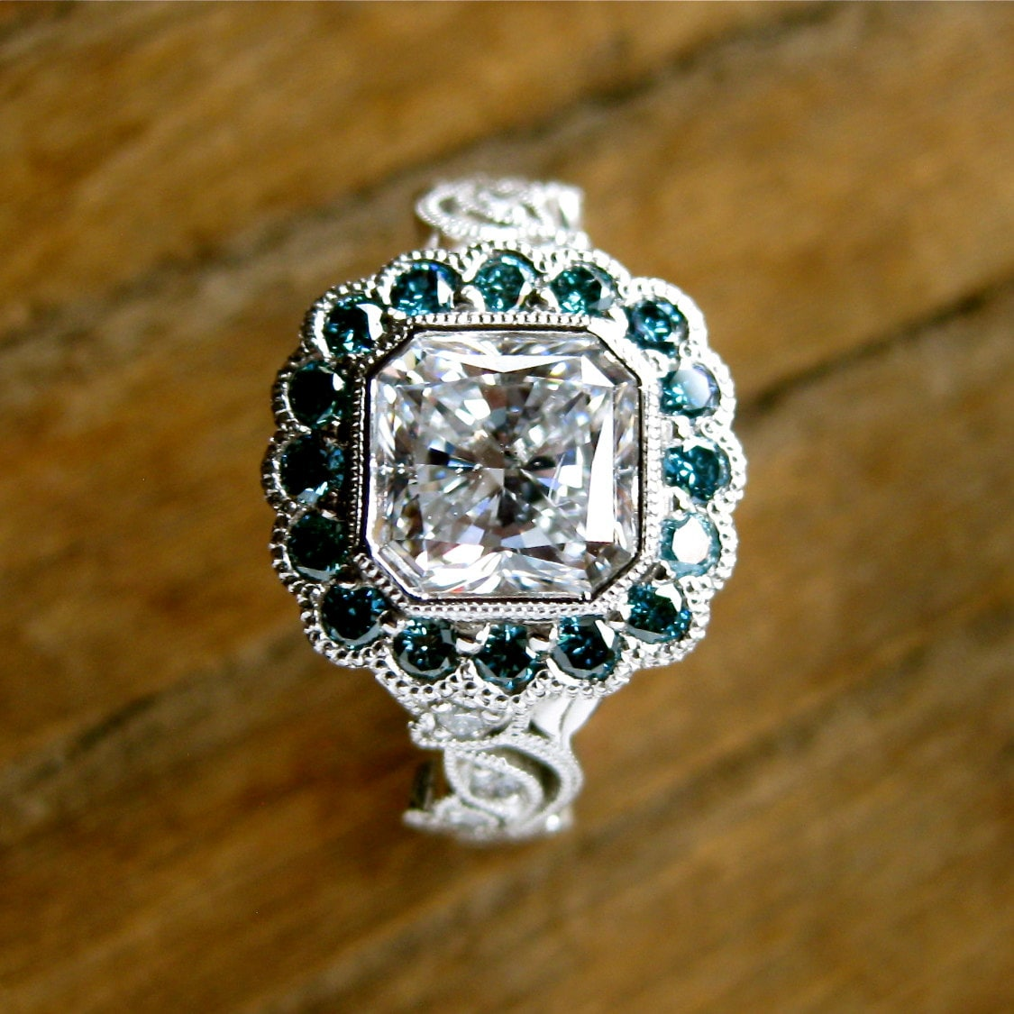 Radiant Cut Diamond Engagement Ring In Platinum With Teal Blue