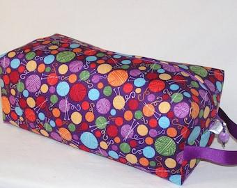 Yarn Balls in Purple Sweater Bag