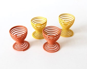 Set of four metal wire egg holders Tomado early 60tees made in Holland.
