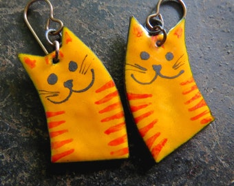 Orange Cat Earrings. Quirky, cute rustic torch fired enamel with handpainted details in red and black by Vintajia Adornments