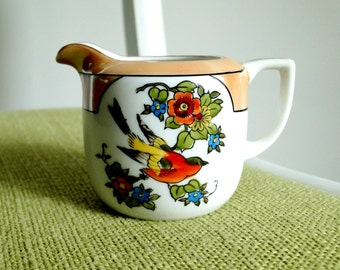Noritake Colorful Bird with Flowers Theme Hand Painted Creamer with Peach Luster Accent