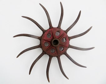 Industrial Cast Iron Starburst Sun Wheel with Exterior Spokes Red and Rust