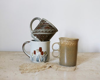 three earthy mugs