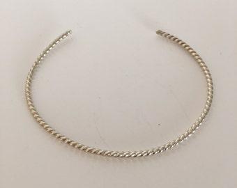 Silver thin twist cuff