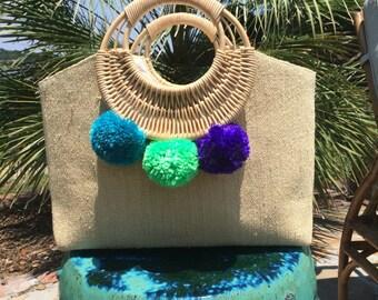 Neon blue/green/purple pom pom straw tote