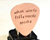 Copper Guitar Pick Handmade and Stamped with When Words Fail Music Speaks - GP500