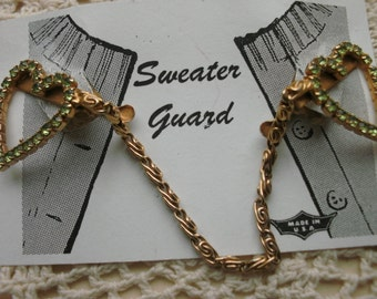 Sweater Clip With Large light Green Prong Set Rhinestones