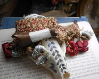 Eulogia. The Goddess of Skull & Bones. Genuine Coyote Leg Bone, Copper and vintage pom pom Tapestry Festival Cuff  bracelet