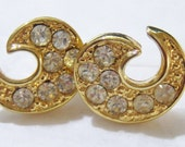 small gold tone with clear rhinestones swirl pierced earrings