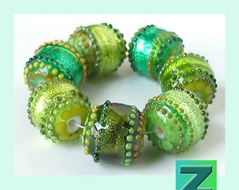 Acid Grass Glimmer Strips - 7 glimmery green beads - lampwork by Sarah Moran