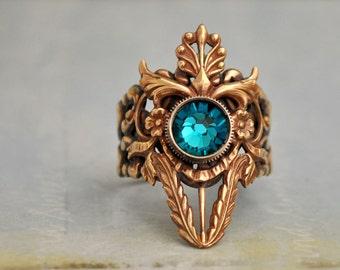 DARK VICTORIAN - Victorian style floral pattern brass ring with blue zircon color Swarovski glass jewel
