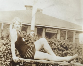Vintage 1930s  young woman posing in bathing suit at park