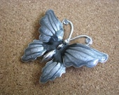 Pretty blue gray enamel & silver tone butterfly pin with rhinestone accents