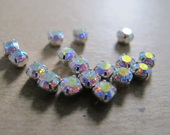 Lot of 17 round Crystal Faceted AB Chatons 3mm, in metal settings