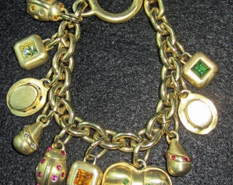 REDUCED Vintage ROXANNE ASSOULIN Gold Plated Rhinestone Charm Bracelet with Toggle Closure