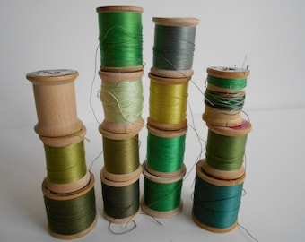 Green 14 vintage wood spools of cotton/nylon thread. Star/Belding/Coats and Clarks
