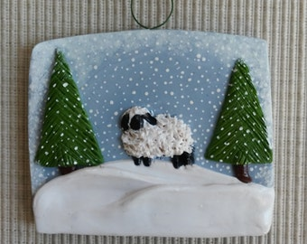 hand sculpted polymer clay sheep in the snow ornament