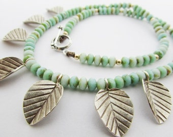 Turquoise necklace with fine silver charms, sterling, layering strand necklace, boho jewelry, bohemian, botanical jewelry, leaf, gold