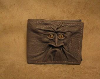 Grichels leather bi-fold wallet - olive green with gold speckled slit pupil reptile eyes
