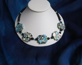 Unique multicolored statement necklace in composite green blue black and ivory white