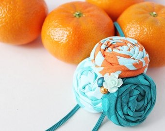 Clementine- orange aqua and teal rosette headbadn bow