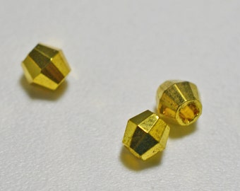 Gold plated faceted bicone, 5mm