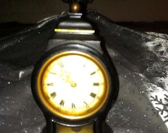Vintage clock black with flowers